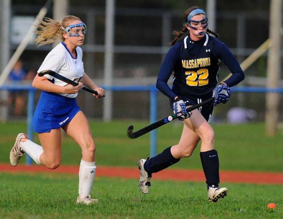 Massapequa High School forward #22 Kelsey O'Brien, right,