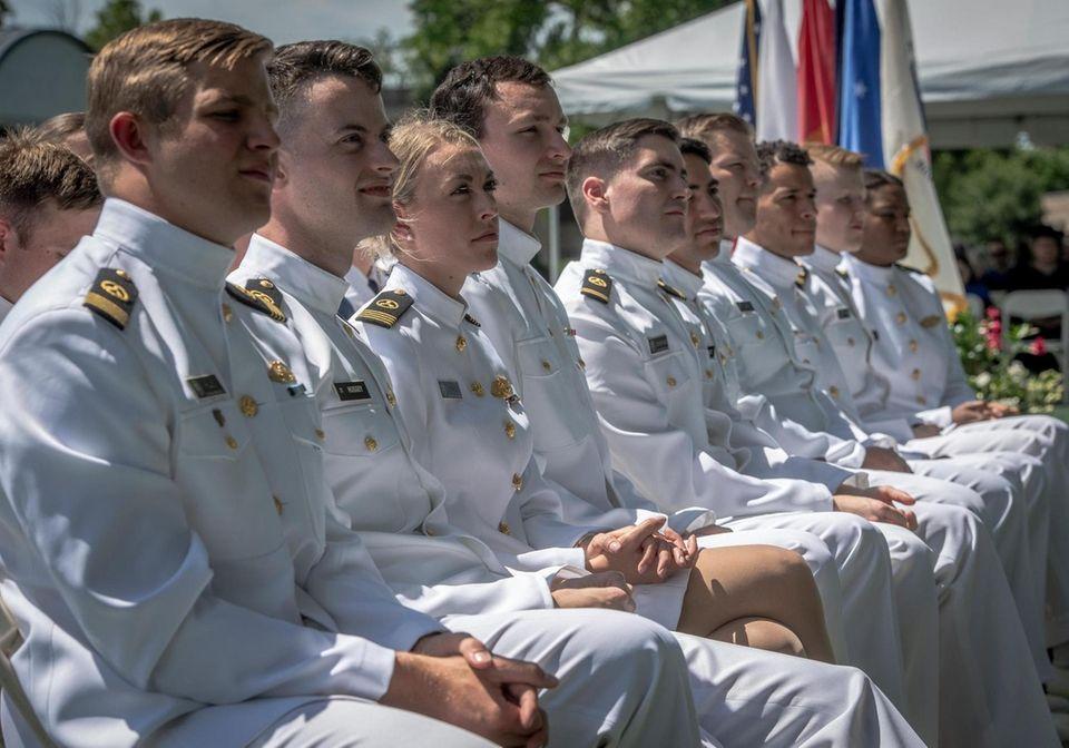 Graduates listening to Valedictorian Midshipman Benjamin Starr address