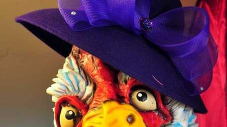 A chicken mask is adorned with a whimsical