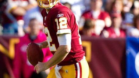 Washington Redskins quarterback John Beck scrambles from Philadelphia