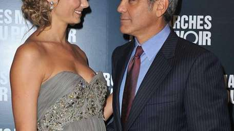 Stacy Keibler and George Clooney attend