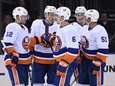 Islanders players after a goal by Ryan Pulock