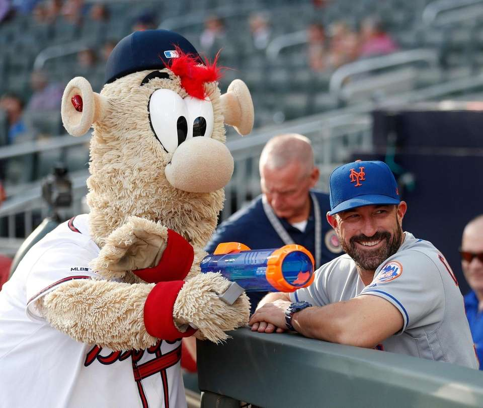Atlanta Braves mascot Blooper takes aim at a