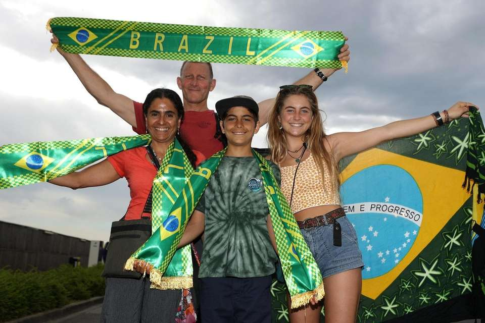 Fans pose for a photograph outside the stadium