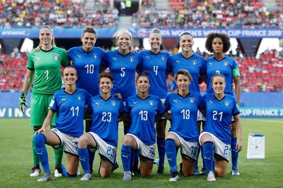 Italy players pose for a photo before a