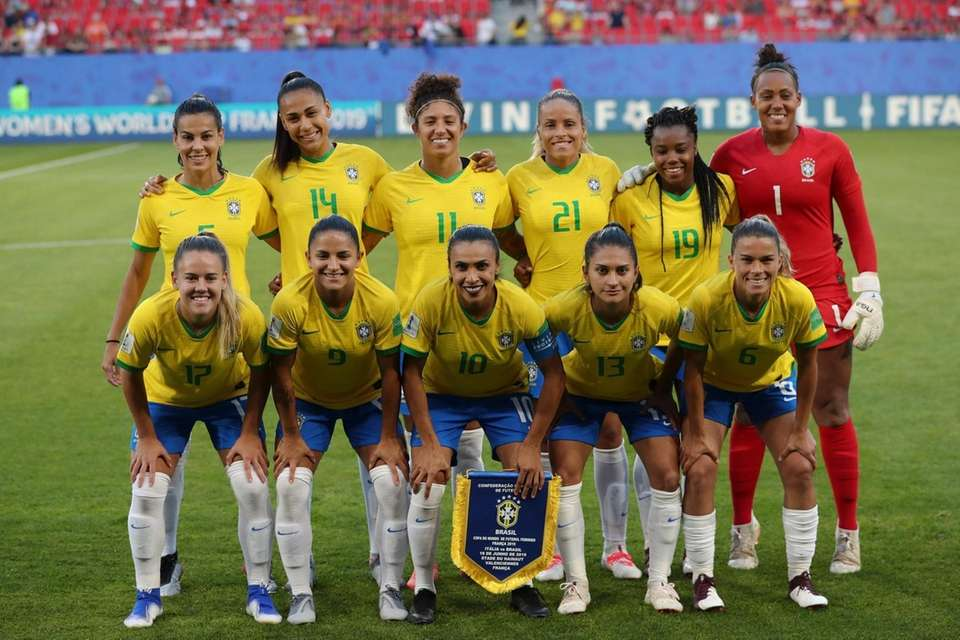 Brazil players pose for a photo before the