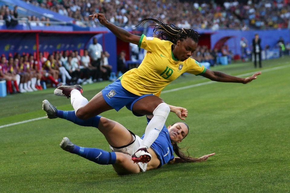 Brazil's Ludmila, left, falls on Italy's Alia Guagni