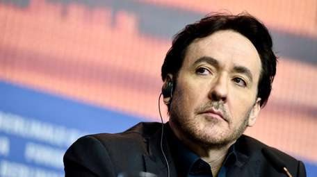Actor John Cusack attends the news conference for