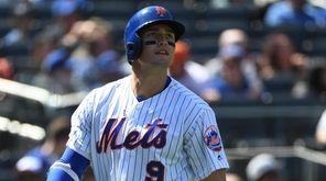 Mets leftfielder Brandon Nimmo returns to the dugout