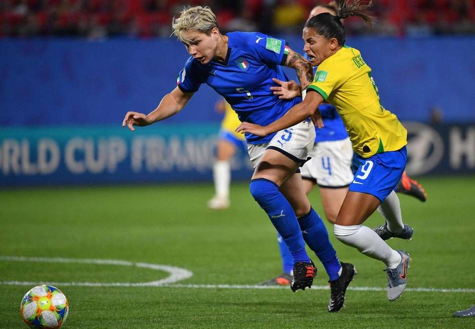 Brazil's forward Debinha (R) is fouled by Italy's