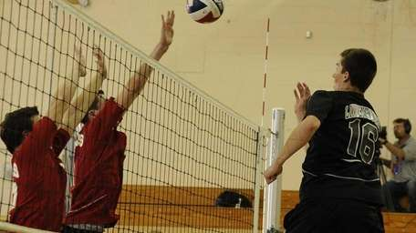 Lindenhurst's Travis VonHolt, 16, hits a kill against