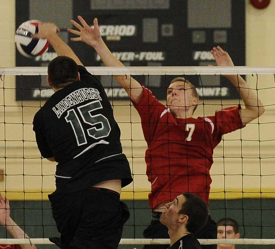 Lindenhurst's Joe Curry, 15, hits a kill past