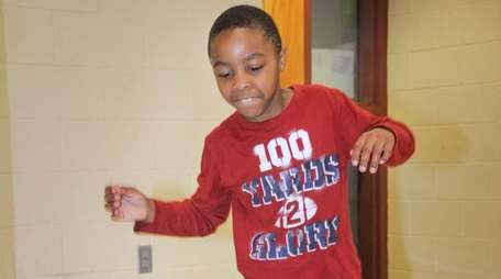 "Second-grader Joshua Taylor, 7, hops along the ""sensory"