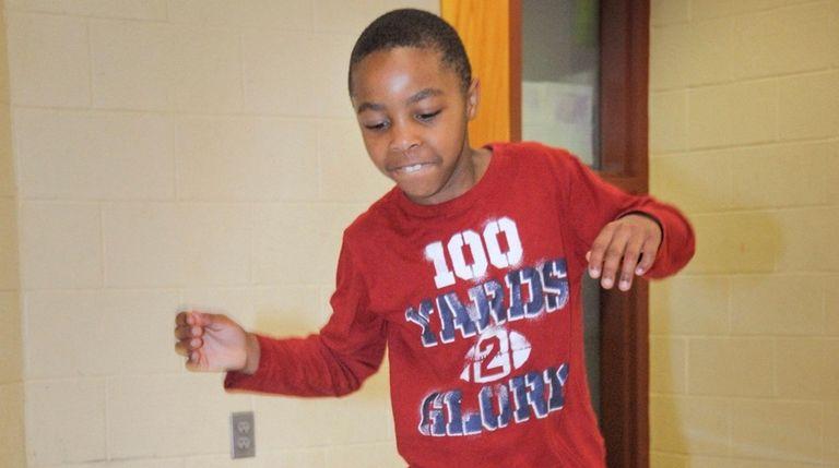 "Second-grader Joshua Taylor, 7, hops along the ""sensory"