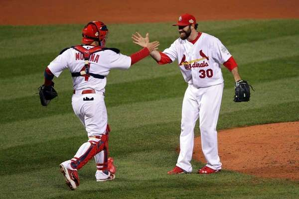 Jason Motte and Yadier Molina of the St.