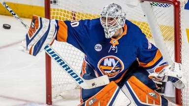 Islanders goalie Robin Lehner makes a stop against