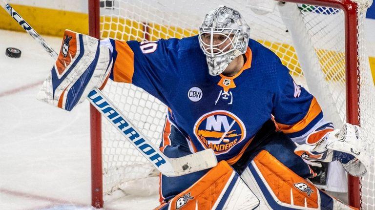 Islanders goalie Robin Lehner makes a stop against