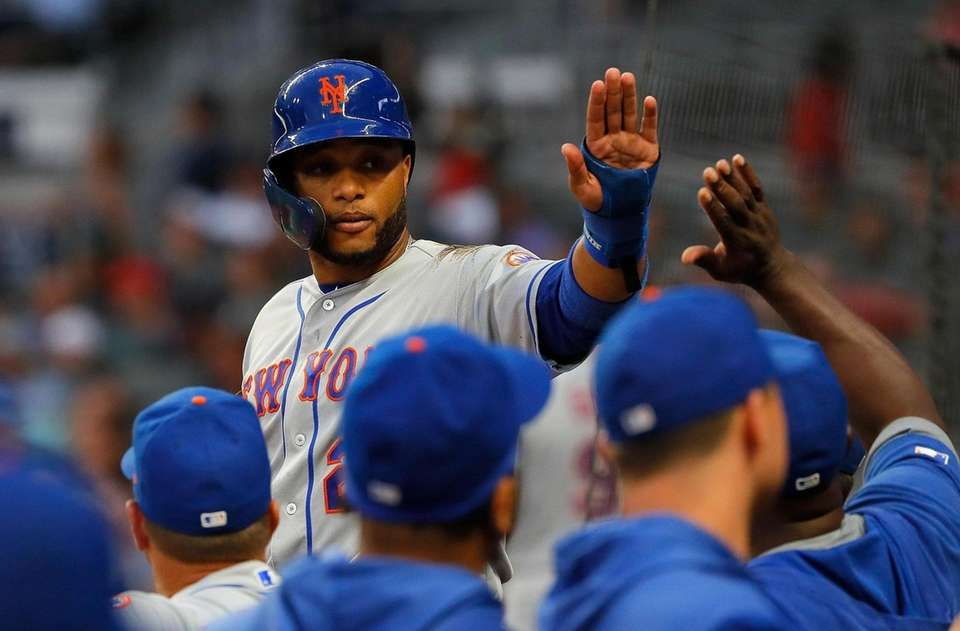Robinson Cano of the Mets reacts after scoring