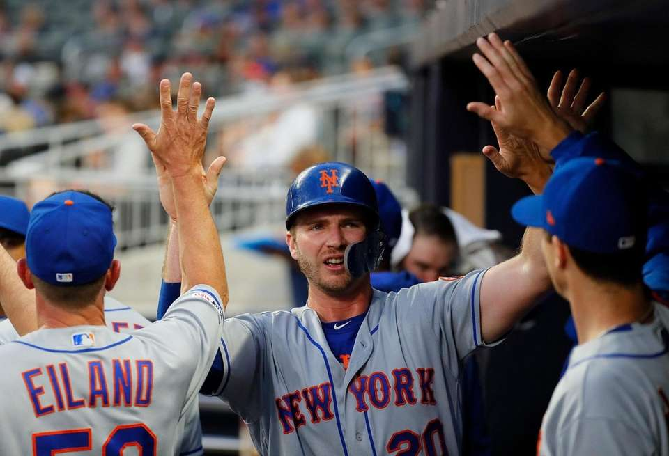 Pete Alonso of the Mets reacts after scoring