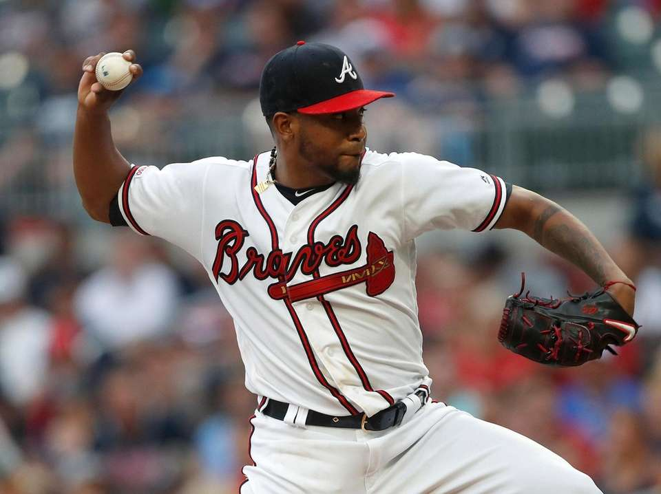 Braves starting pitcher Julio Teheran works against the