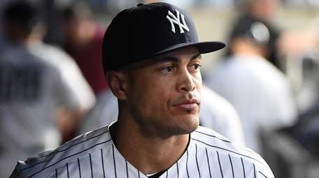 Yankees rightfielder Giancarlo Stanton looks on from the