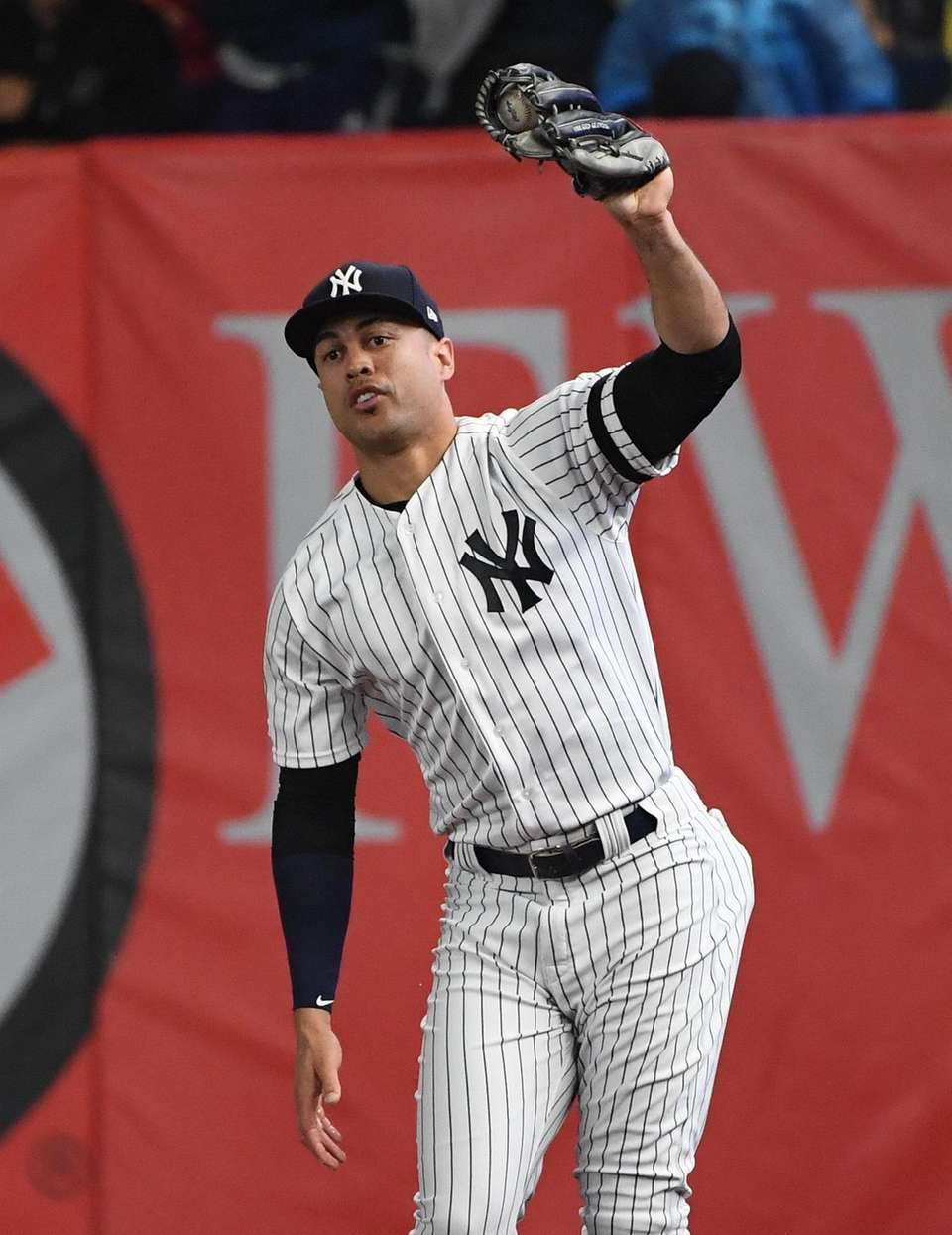 New York Yankees right fielder Giancarlo Stanton holds