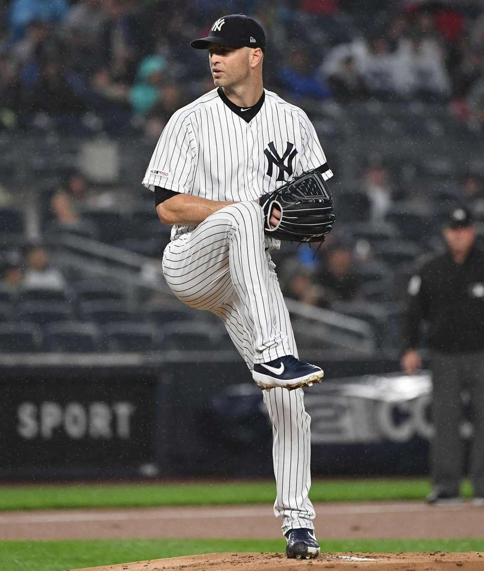 New York Yankees starting pitcher J.A. Happ delivers