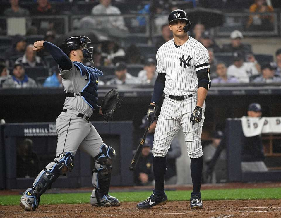 New York Yankees right fielder Giancarlo Stanton reacts