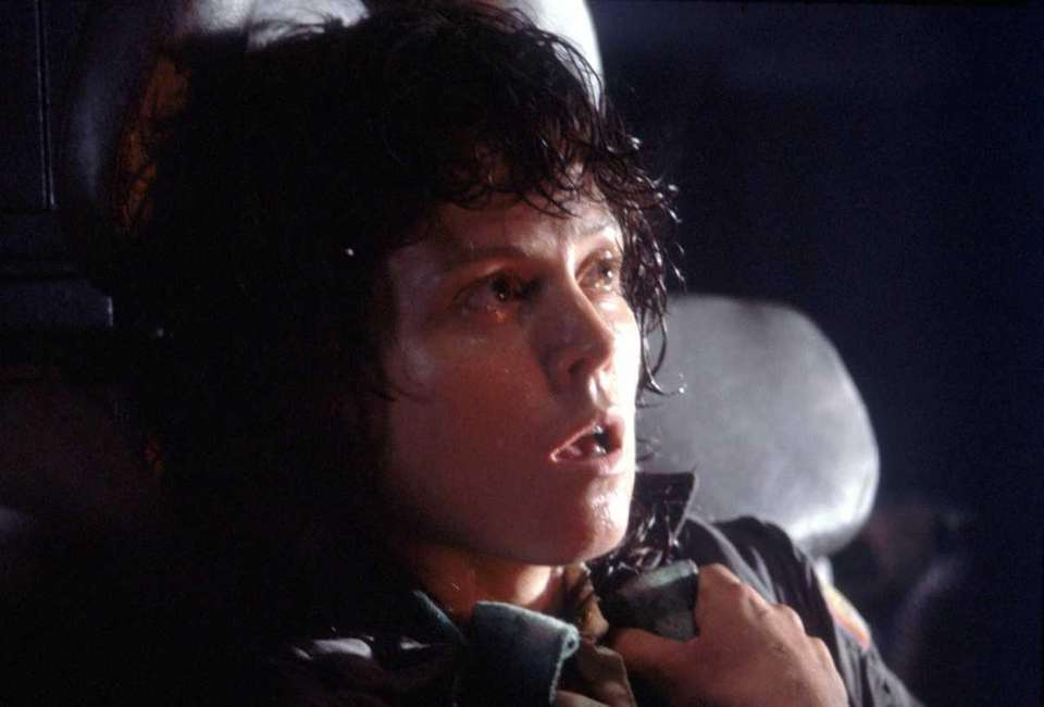 A shaken Ripley (Sigourney Weaver) reacts to the