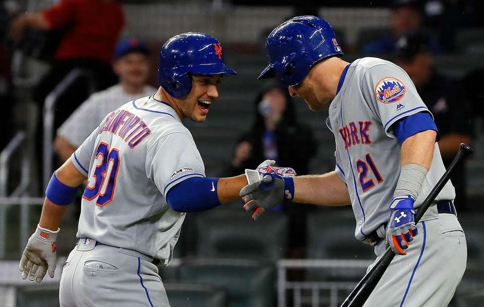 Michael Conforto of the Mets reacts with Todd
