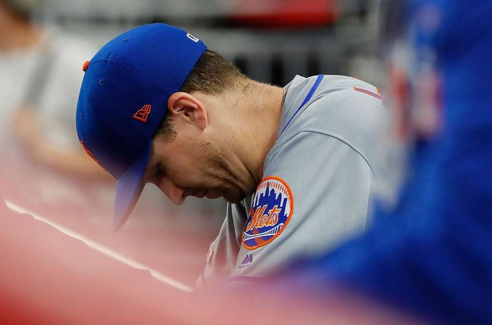 Jacob deGrom of the Mets reacts from being