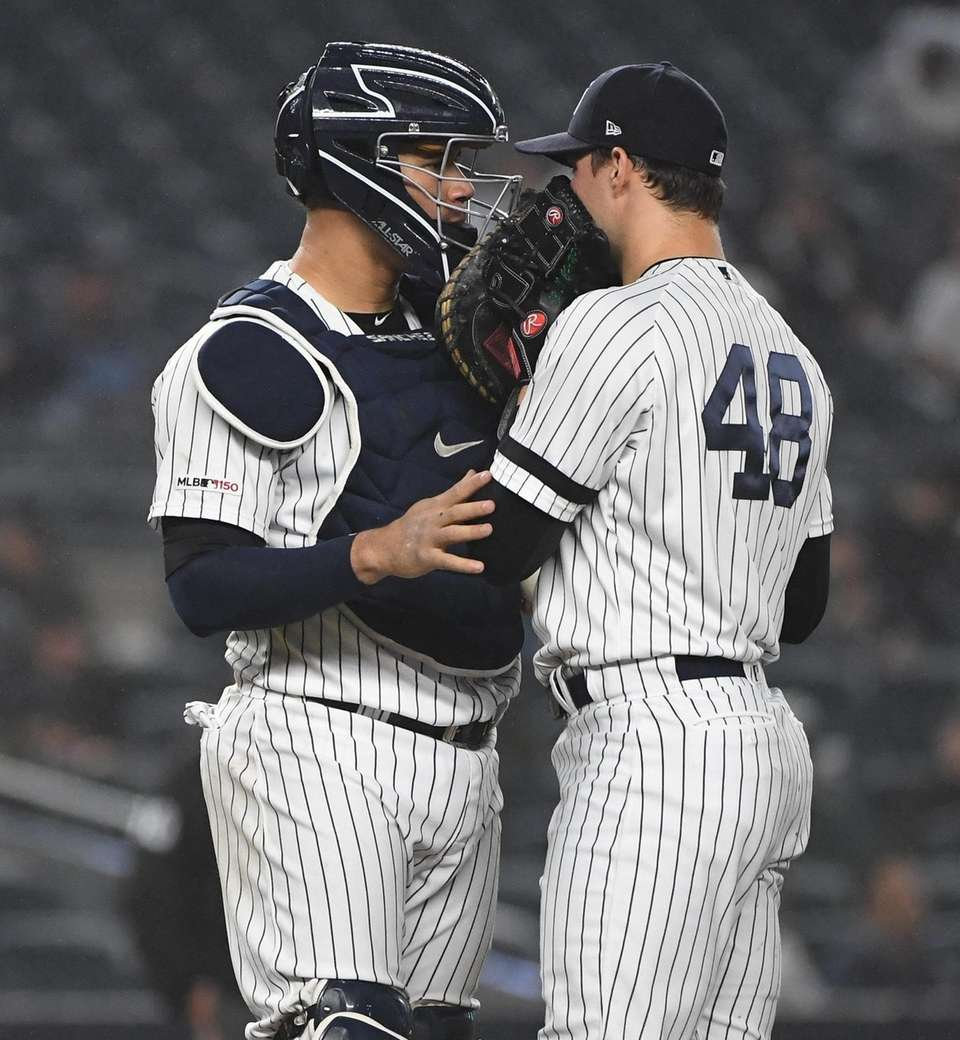 New York Yankees catcher Gary Sanchez talks to