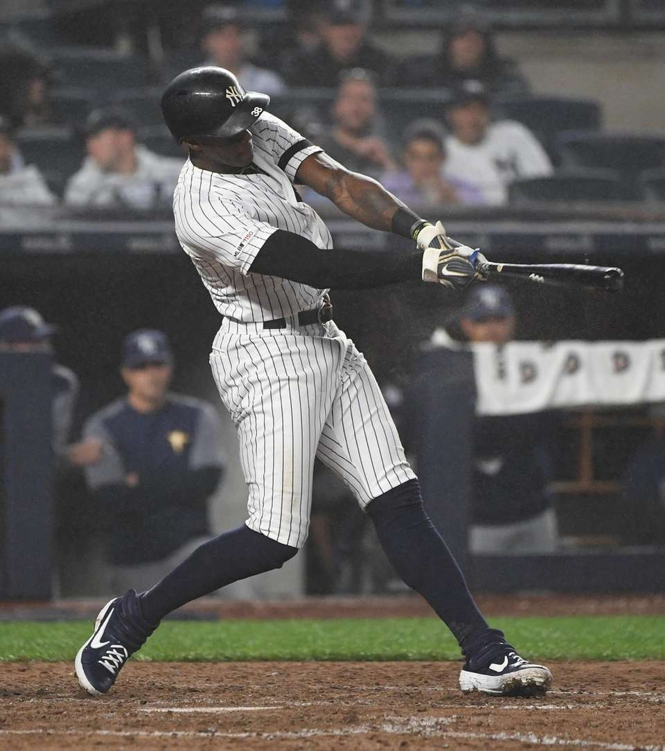 New York Yankees left fielder Cameron Maybin singles