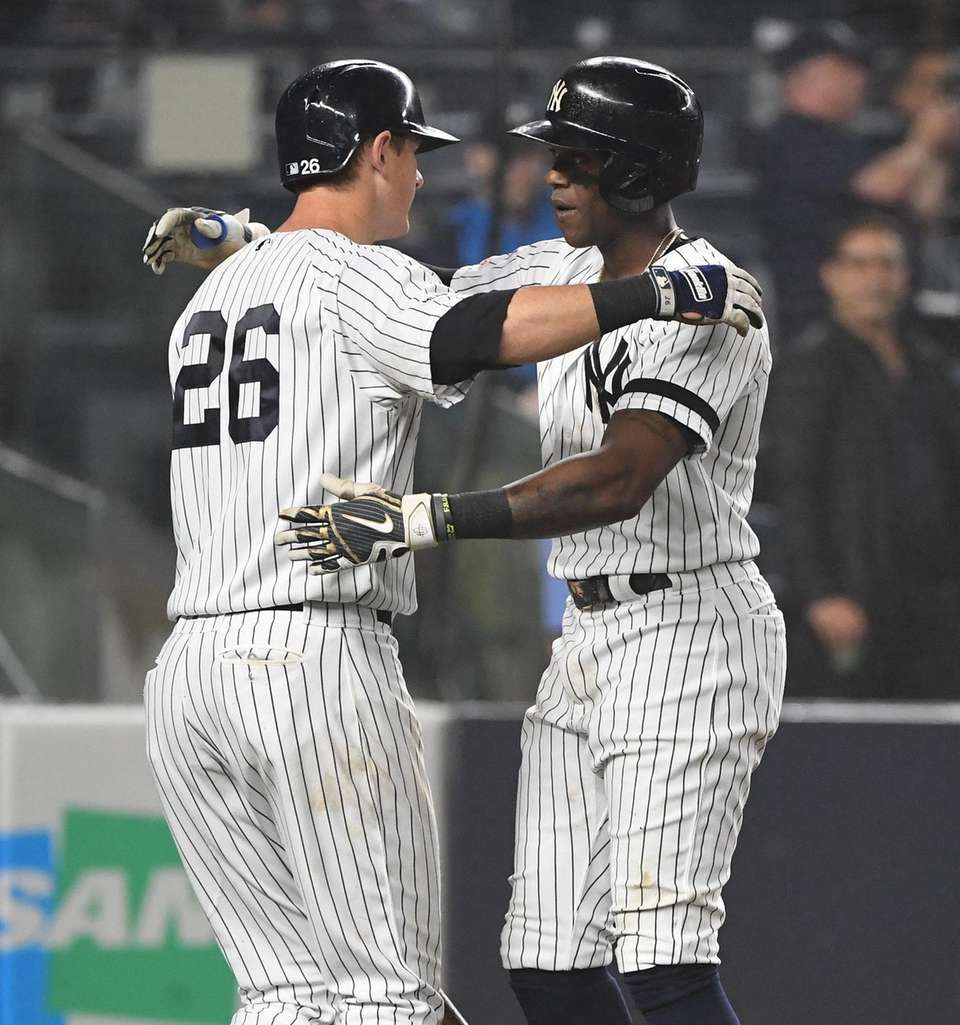 New York Yankees left fielder Cameron Maybin, right,