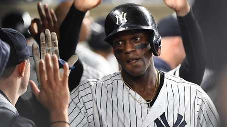 Yankees leftfielder Cameron Maybin is greeted in the