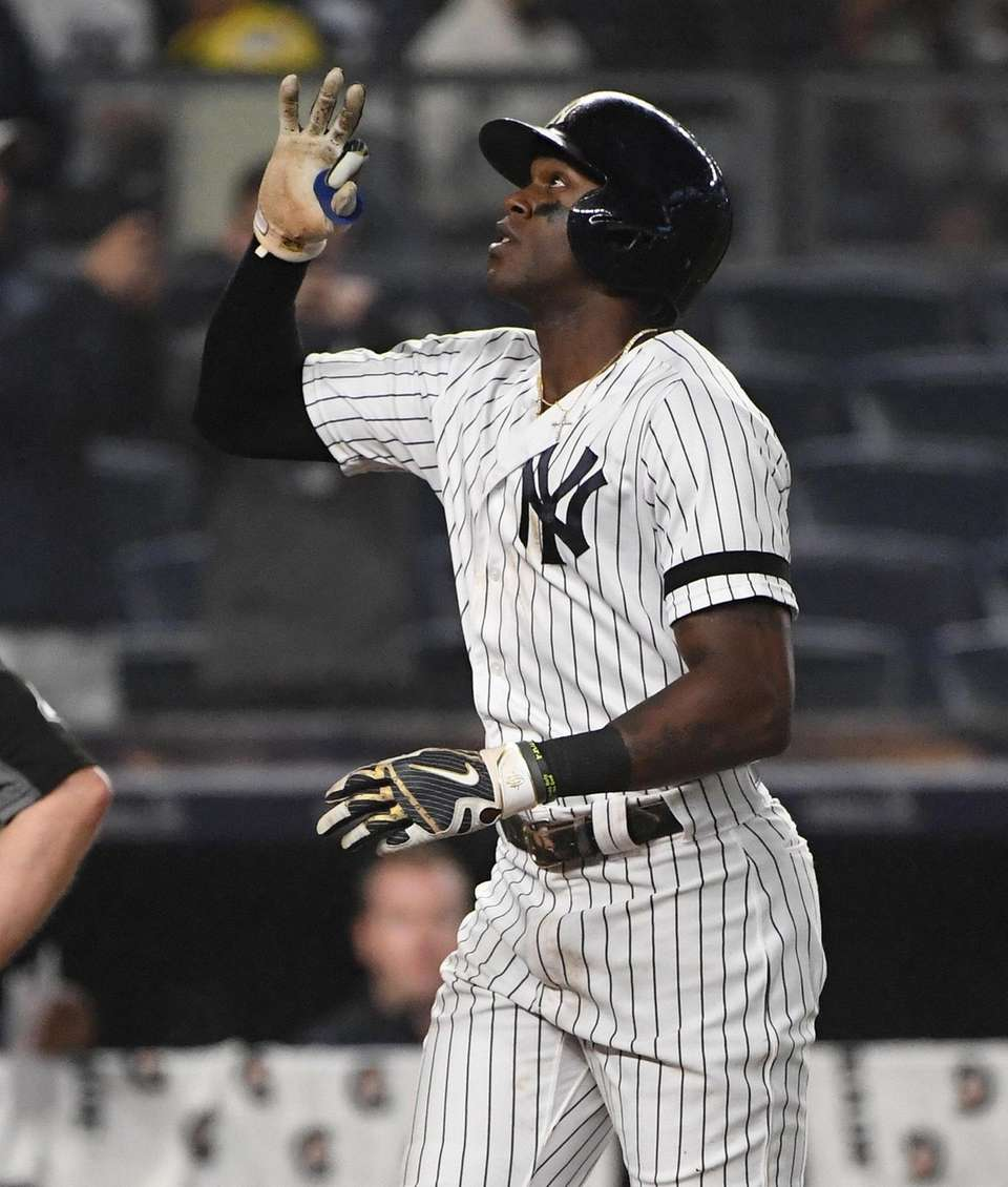 New York Yankees left fielder Cameron Maybin reacts