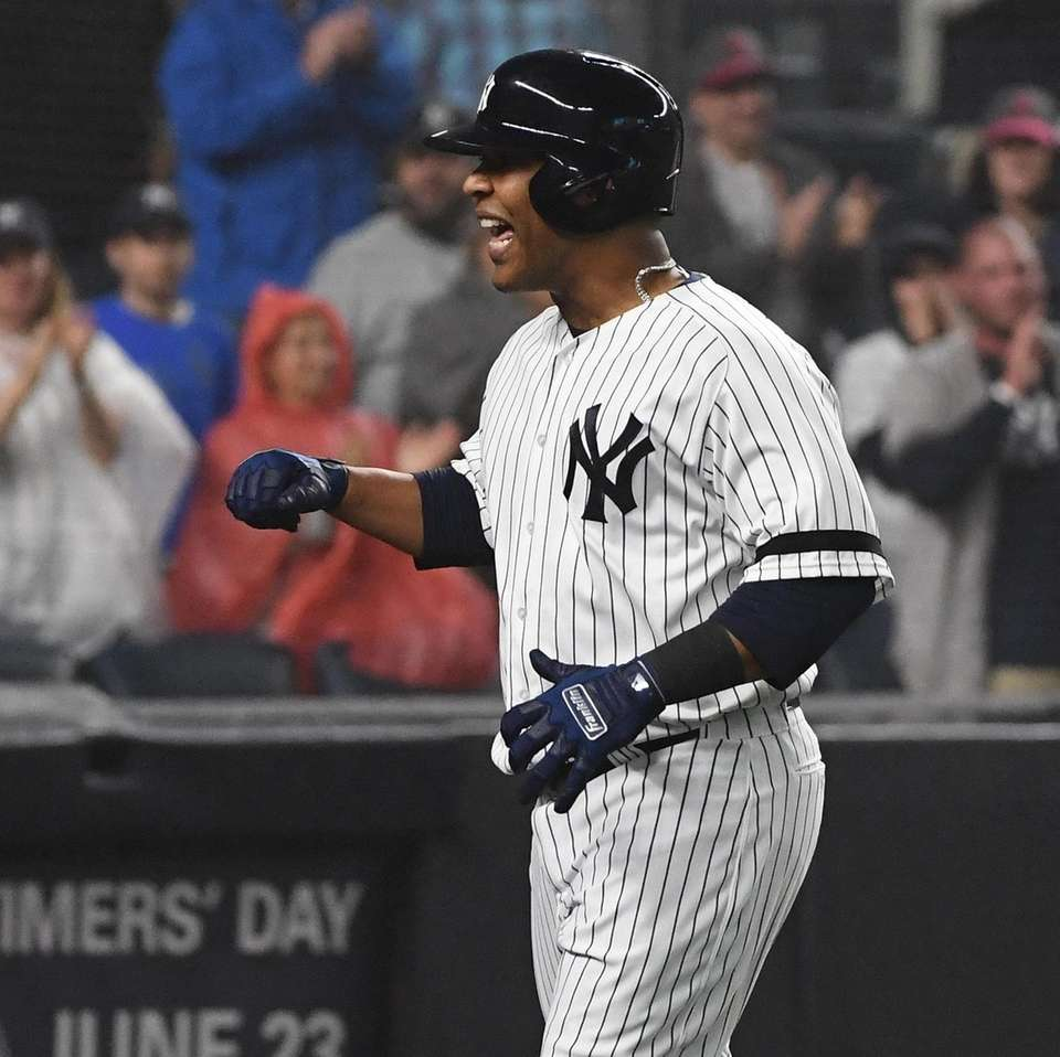 Yankees designated hitter Edwin Encarnacion reacts as he