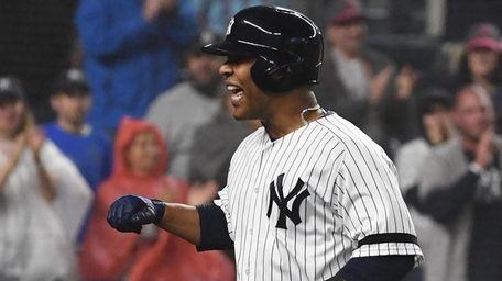 Yankees designated hitter Edwin Encarnacion reacts as he