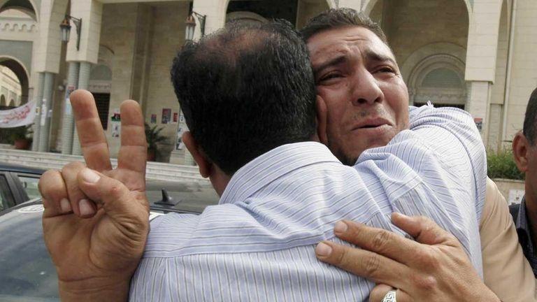 Libyans react to Moammar Gadhafi's death in Tripoli,
