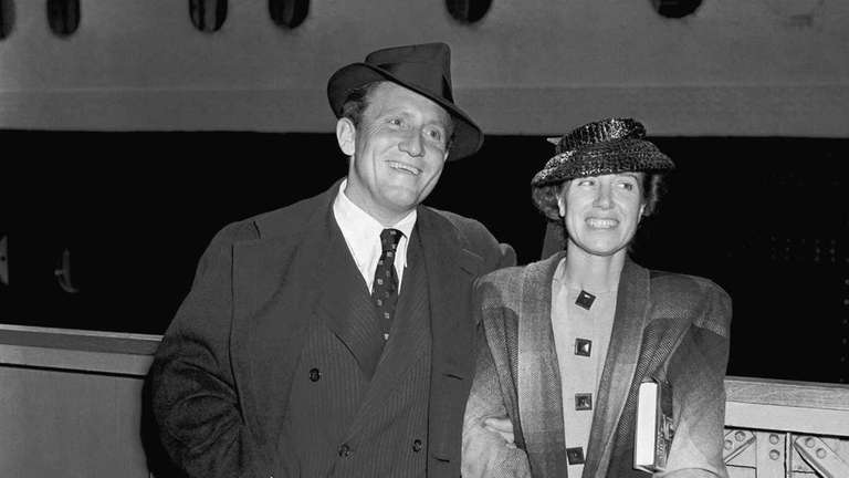 Mr. Spencer Tracy, left, and his wife Mrs.