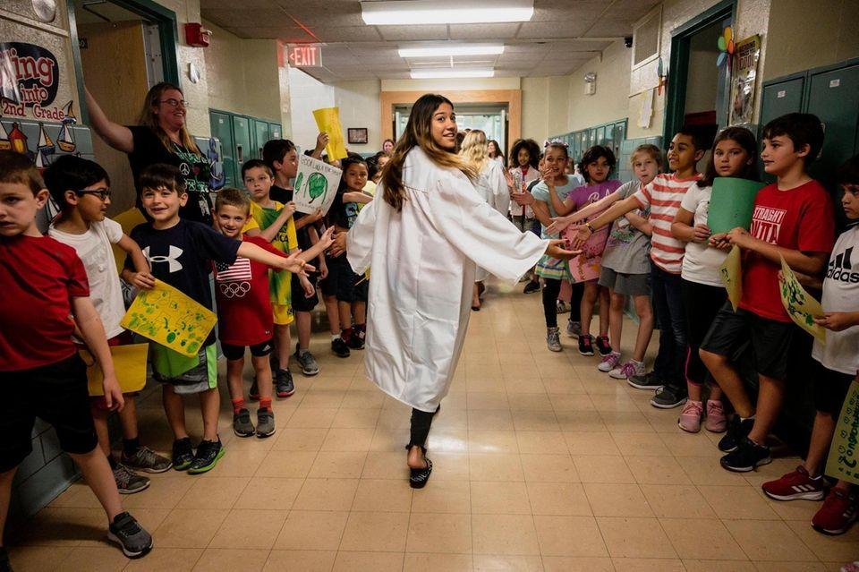 Farmingdale High School Senior Emily Diaz is greeted