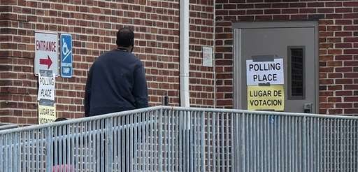 Voters head into the polling place at the