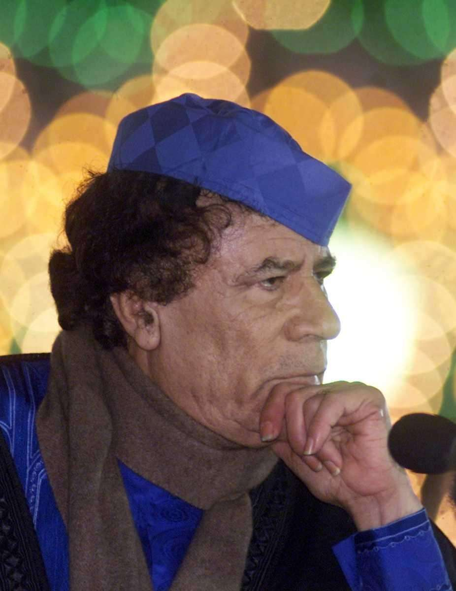 Libyan leader Moammar Gadhafi listens to questions during