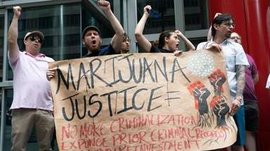 Marijuana legalization supporters rally Sunday in Manhattan.