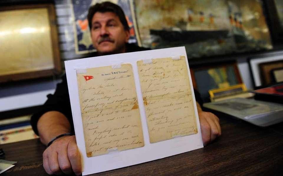 Auctioneer Philip Weiss holds a letter on RMS