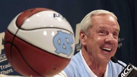 North Carolina coach Roy Williams answers a question