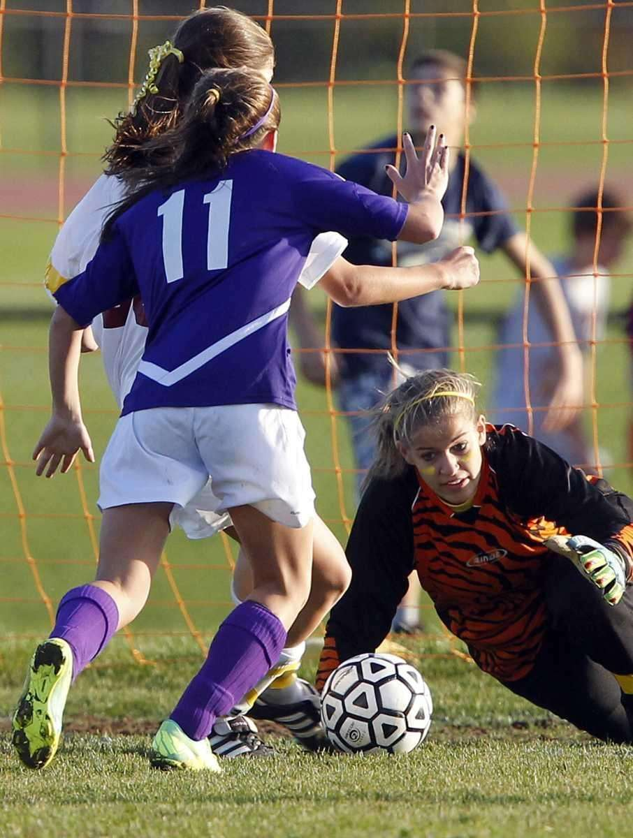 Kings Park's keeper Carley Grecco dives for the