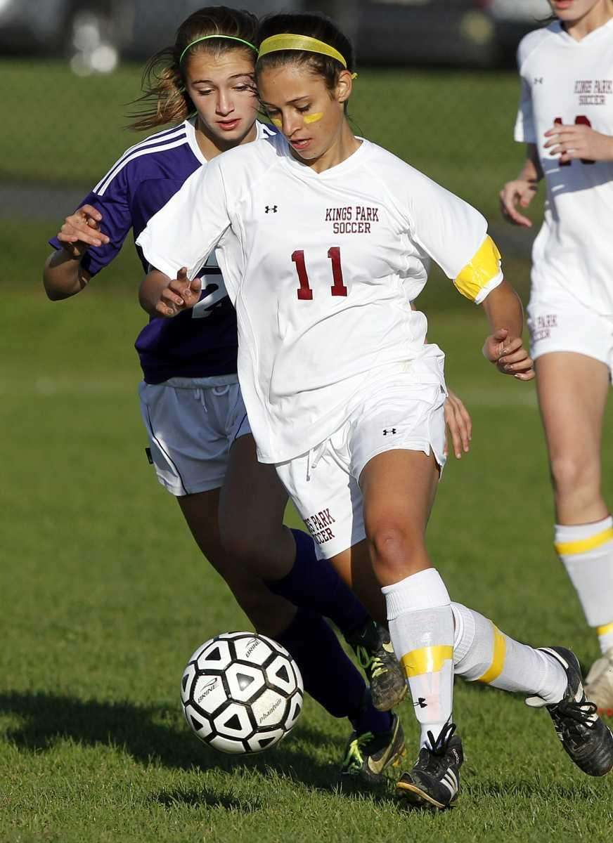 Kings Park's Michelle Yaniello (11) dribbles around Islip