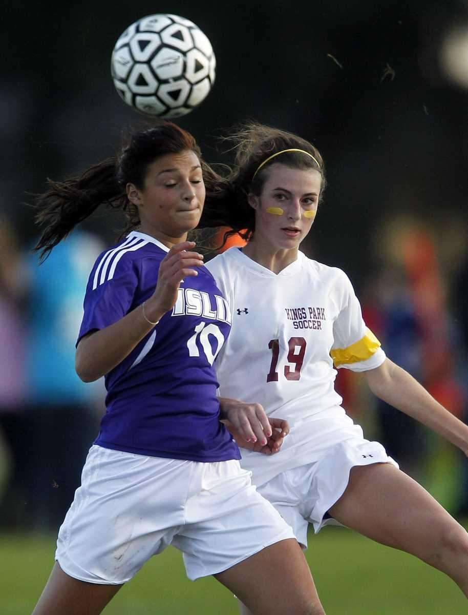 Islip's Tara Mackey (10) heads the ball in
