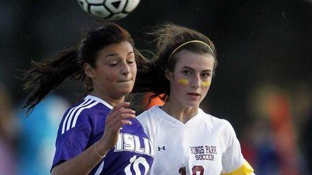 Islip's Tara Mackey (10) heads the ball in